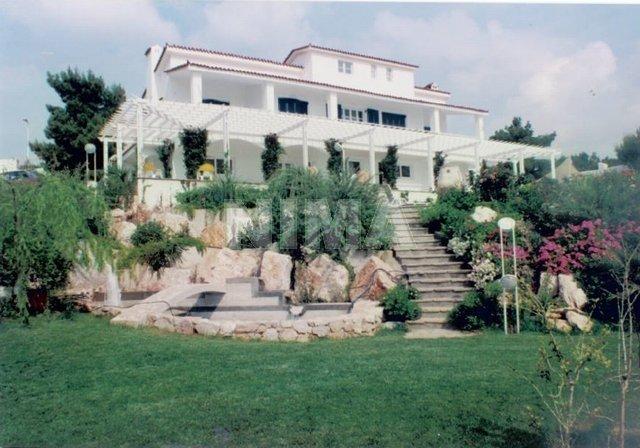 Недвижимость в остров Порто Рафти на побережье цены